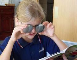 girl testing glasses